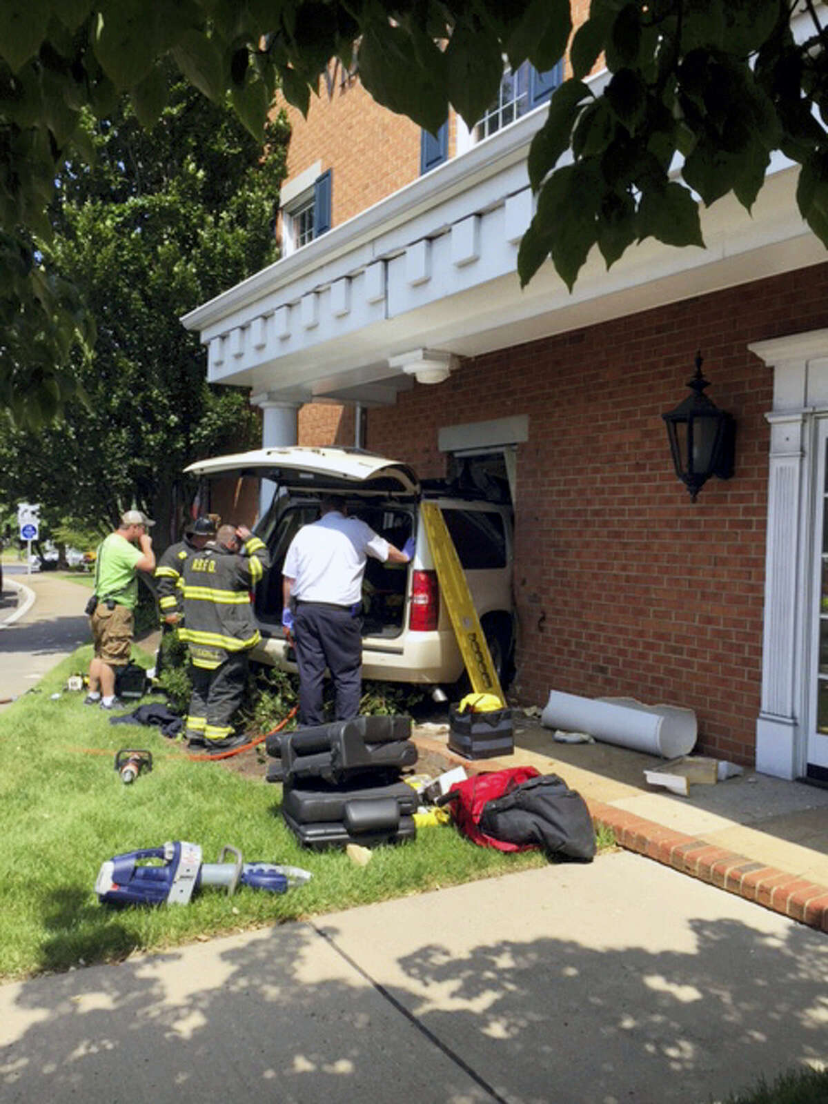 First responders work at the scene of an automobile accident in Red Bank, N.J. Former Red Sox and Mets infielder John Valentin and his mother were injured when the SUV he was driving crashed into the building used by Visiting Nurse Association.