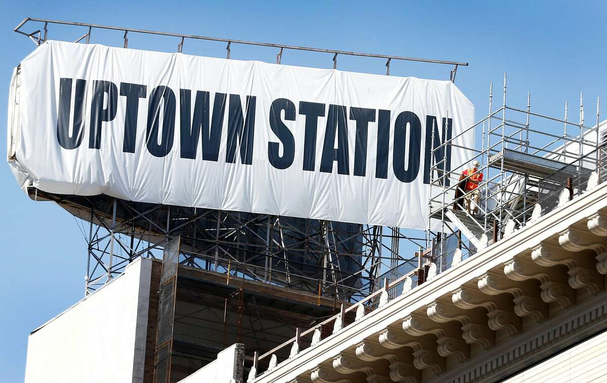 A construction worker on the roof of the Uptown Station redevelopment project at 20th Street and Broadway in Oakland.