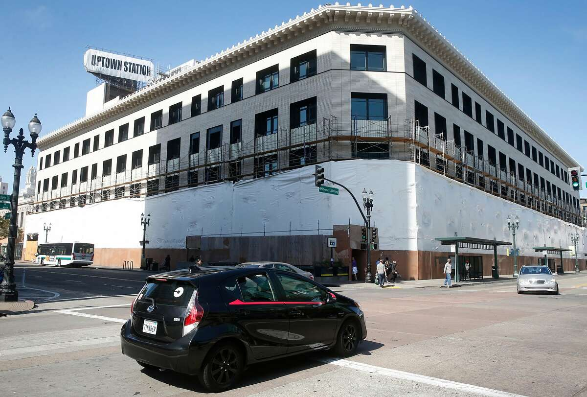 An Uber driver turns onto Broadway from 20th Street in front of the Uptown Station redevelopment project in Oakland.