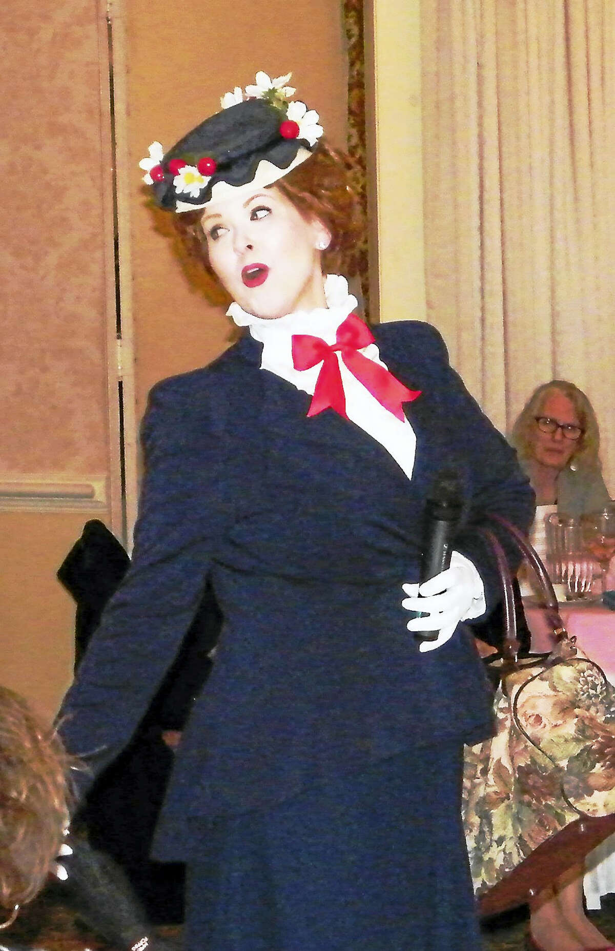 """Actress Rebekah Derrick performed her role as """"Mary Poppins"""" at the recent Charlotte Hungerford Hospital auxiliary's fashion show."""