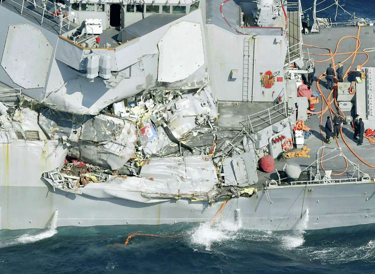 The damage of the right side of the USS Fitzgerald is seen off Shimoda, Shizuoka prefecture, Japan, after the Navy destroyer collided with a merchant ship, Saturday, June 17, 2017. Seven Navy sailors are missing and one was injured after a U.S. destroyer collided early Saturday morning with the Philippine-registered container ship off the coast of Japan, the country's coast guard reported.
