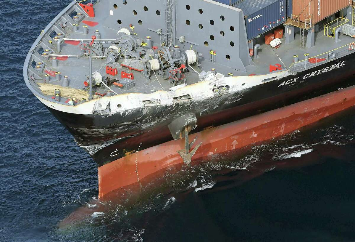 The damage of Philippine-registered container ship ACX Crystal is seen off Izu Oshima, Japan, after it collided with the USS Fitzgerald, Saturday, June 17, 2017. The Japan coast guard said it received an emergency call from a Philippine-registered container ship ACX Crystal early Saturday that it had collided with the USS Fitzgerald.