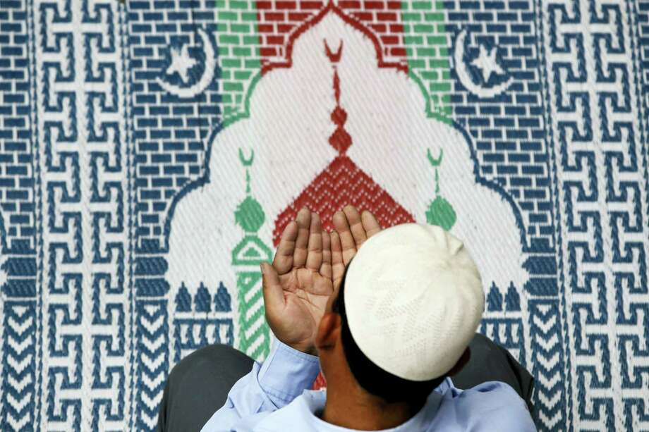A Nepalese Muslim prays inside a mosque in Kathmandu, Nepal, Friday. Muslims across the world are observing the holy fasting month of Ramadan, where they abstain from food, drink and other pleasures from sunrise to sunset. Photo: NIRANJAN SHRESTHA/THE ASSOCIATED PRESS  / Copyright 2017 The Associated Press. All rights reserved.