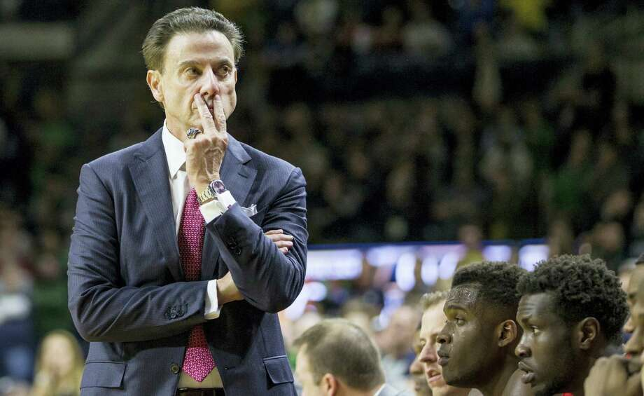 In this Jan. 4, 2017 photo, Louisville head coach Rick Pitino looks on as his team falls behind late in the second half of an NCAA college basketball game against Notre Dame in South Bend, Ind. The NCAA suspended Pitino on June 15, 2017 for five ACC games following sex scandal investigation. A former men's basketball staffer is alleged to have hired strippers to entertain players and recruits. Photo: AP Photo — Robert Franklin, File  / FR17139 AP