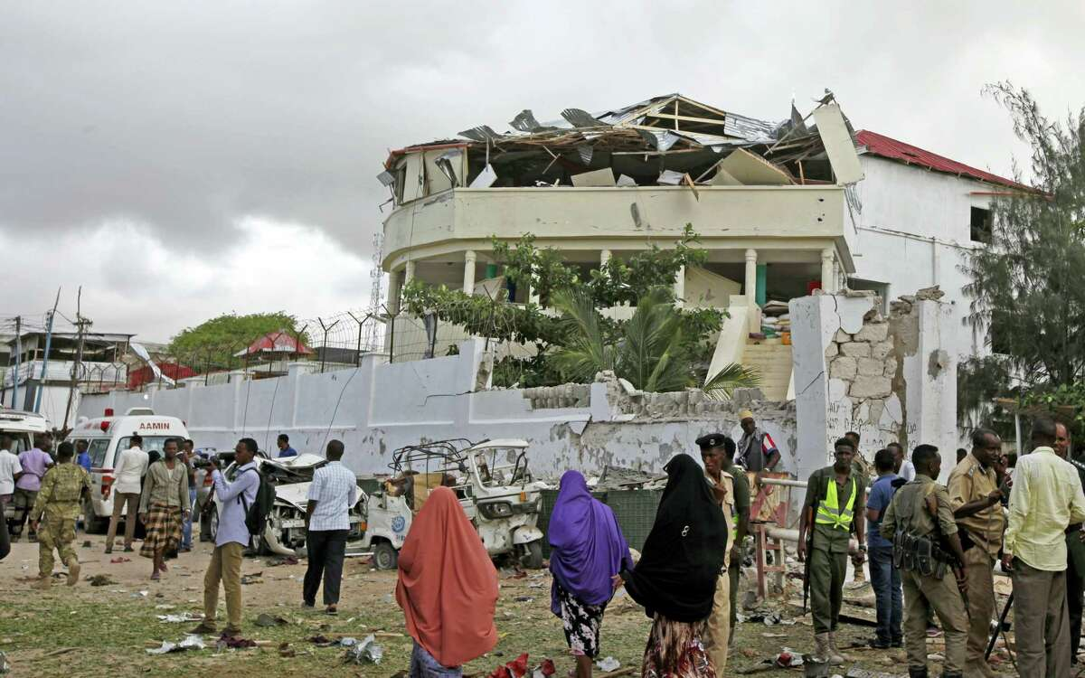 AP Photo/Farah Abdi Warsameh Somalis gather outside a destroyed building near a restaurant that was the scene of a car bomb blast and gun battle in Mogadishu, Somalia Thursday, June 15, 2017. Somali survivors early Thursday described harrowing scenes of the night-long siege of a popular Mogadishu restaurant by al-Shabab Islamic extremists that was ended by security forces.