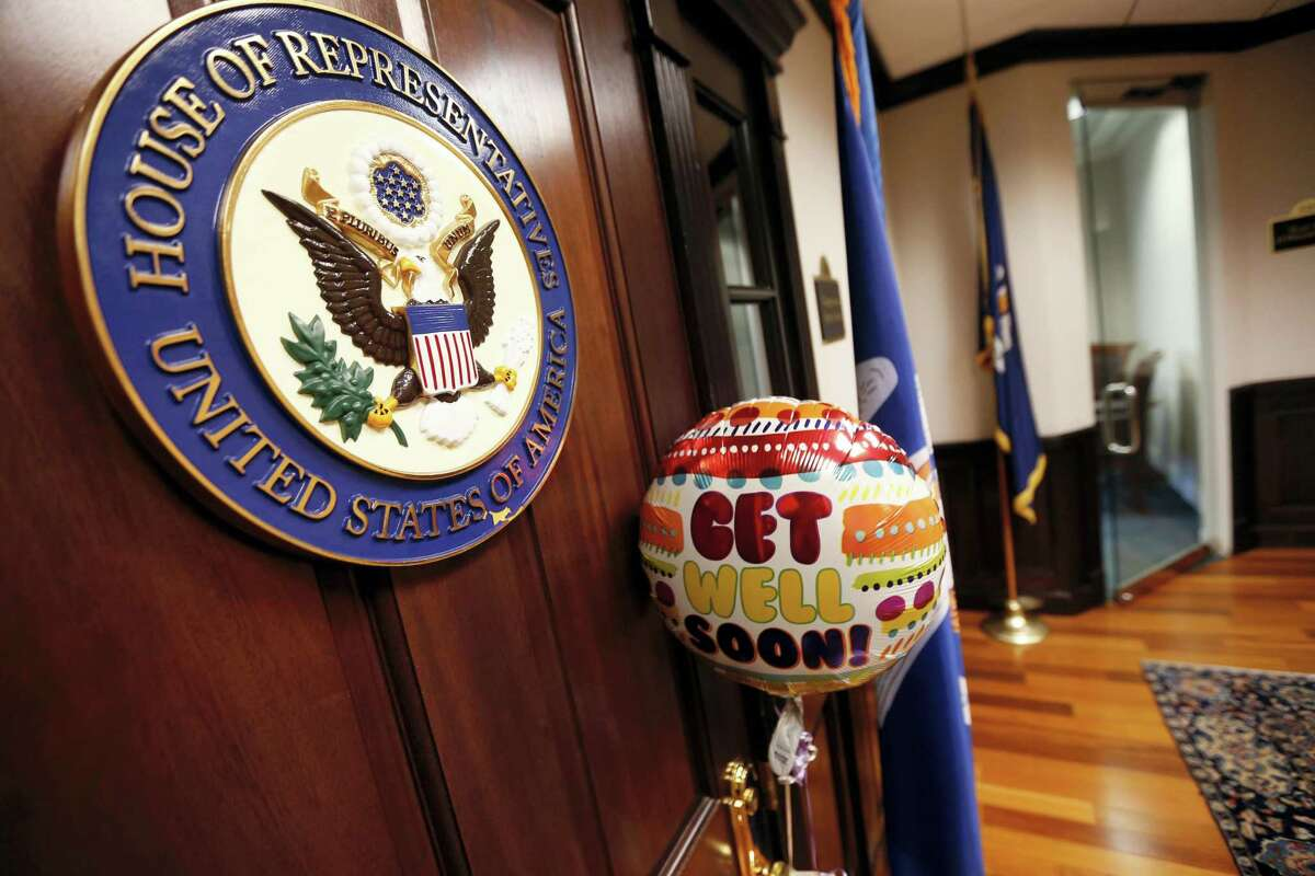 A balloon and card from the office of Sen. Bill Cassidy, R-La., is seen tied to the door of the closed office of Rep. Steve Scalise, R-La., in Metairie, La., Wednesday, June 14, 2017. Scalise was shot while practicing with fellow lawmakers for a congressional baseball game in Alexandria, Va.