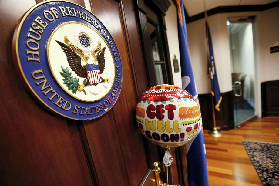 A balloon and card from the office of Sen. Bill Cassidy, R-La., is seen tied to the door of the closed office of Rep. Steve Scalise, R-La., in Metairie, La., Wednesday, June 14, 2017. Scalise was shot while practicing with fellow lawmakers for a congressional baseball game in Alexandria, Va. Photo: AP Photo/Gerald Herbert   / Copyright 2017 The Associated Press. All rights reserved.