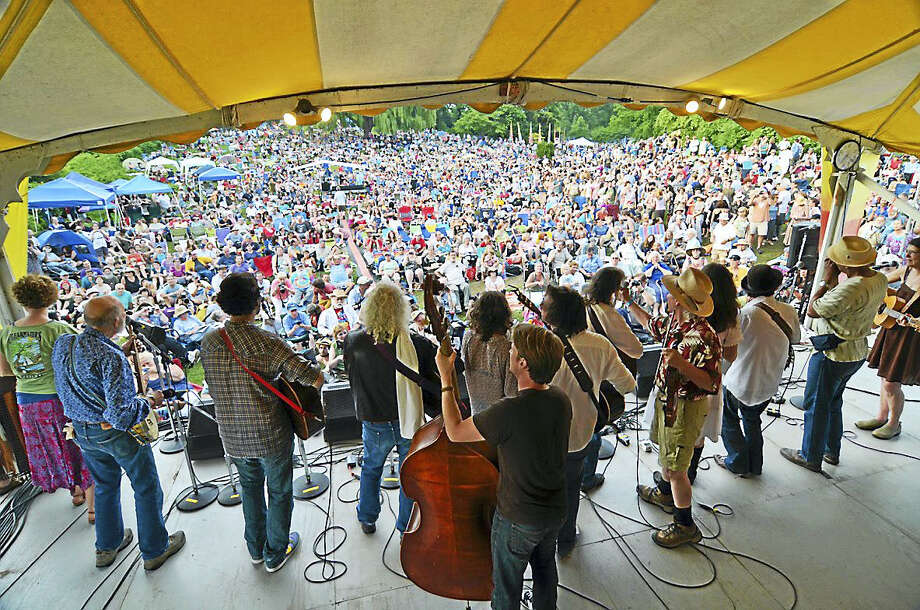 Augusto F. Menezes photo  A view of the Clearwater Festival crowd and some of its performers from the rear of one of its seven stages. That's the late folk music icon and festival co-founder Pete Seeger, second from left. Photo: Digital First Media