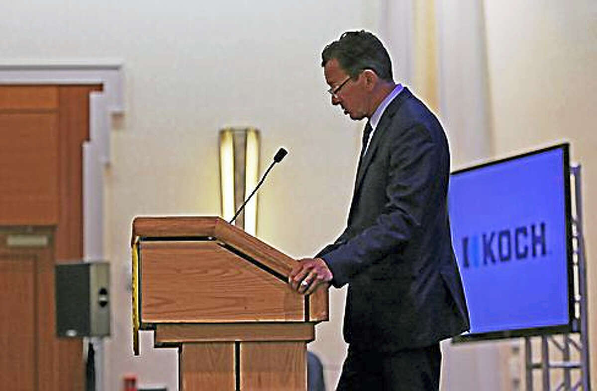 """Gov. Dannel P. Malloy introduces Valerie Jarrett Wednesday at the """"Reimagining Justice"""" conference."""