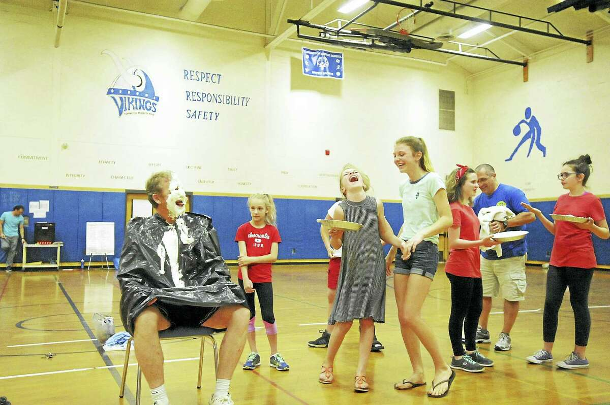 Torrington Middle School students and staff took part in a dodgeball tournament and pieing to raise funds for charity and the school debate team. Above, students laugh after giving assistant principal Charlie McSpiritt a pie in the face during the fundraiser, which benefits the upcoming Relay for Life and the school's debate team.