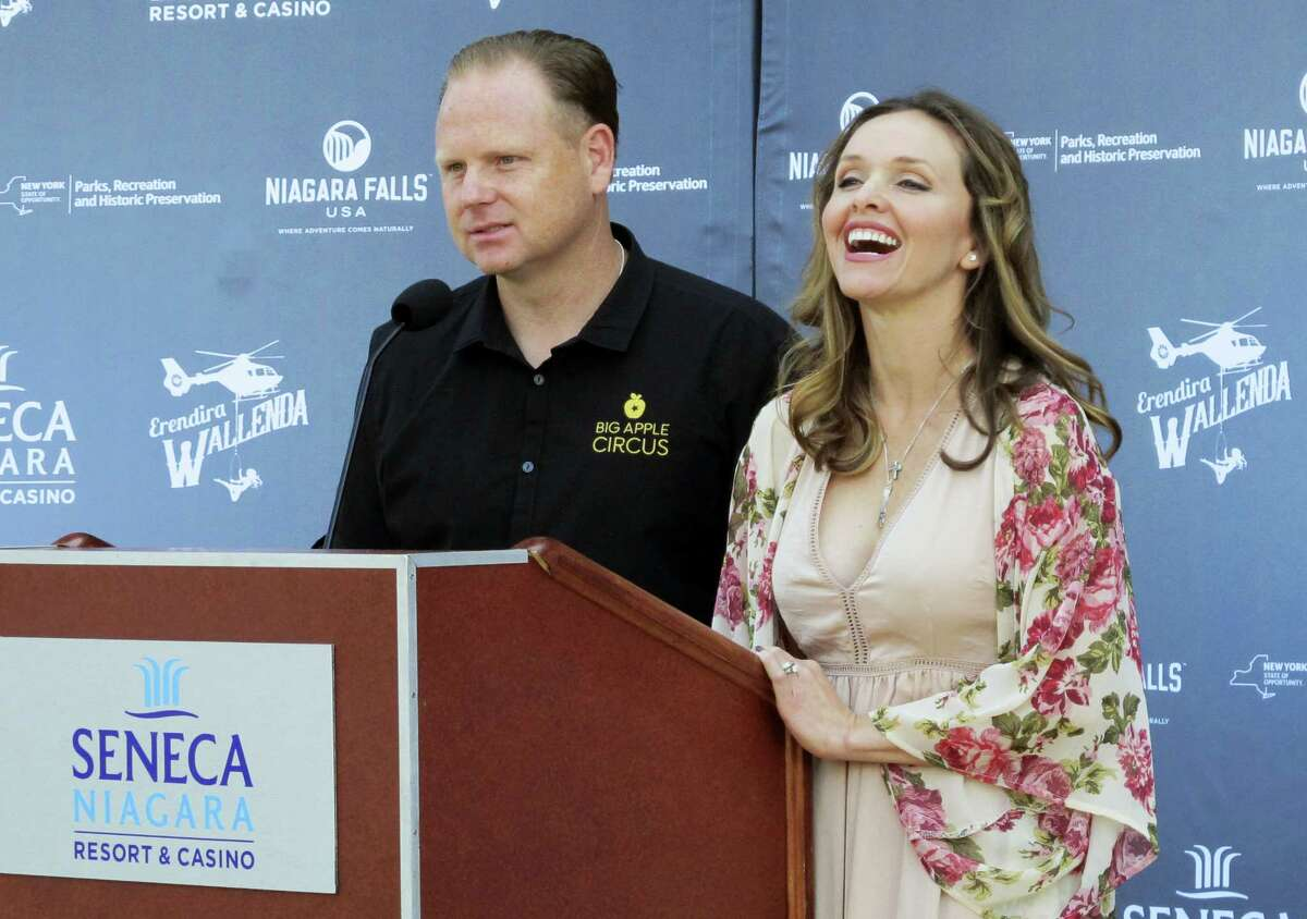 Trapeze-artist Erendira Wallenda smiles as she and her daredevil husband Nik Wallenda describe Erendira's plans to perform an acrobatic routine while suspended from a helicopter above Niagara Falls, at a news conference on June 14, 2017 at the Seneca Niagara Casino in Niagara Falls, N.Y. The stunt is planned for Thursday, June 15, the fifth anniversary of Nik Wallenda's televised 1,800-foot tightrope walk from the New York side of Niagara Falls into Canada.