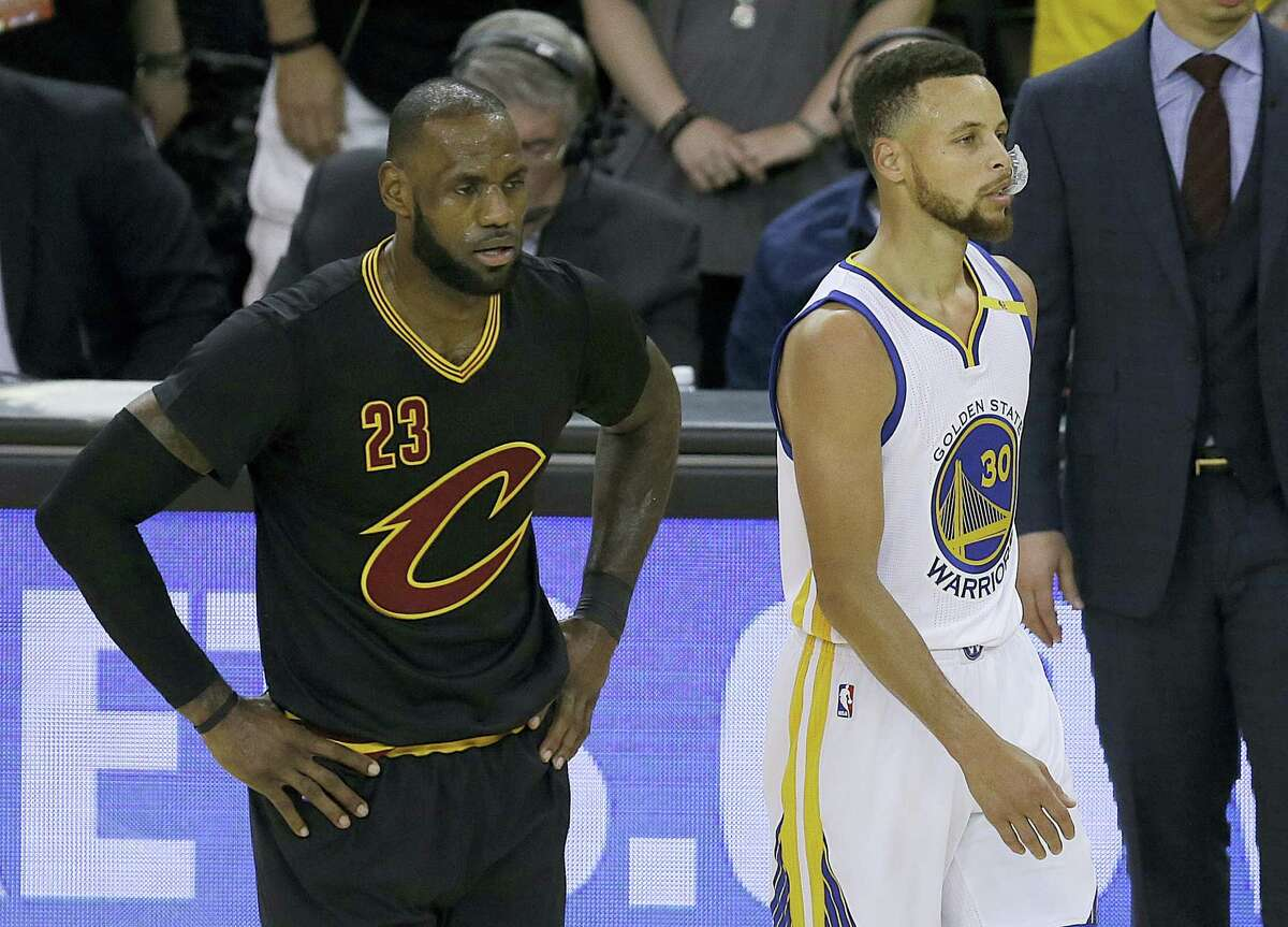 Cleveland Cavaliers forward LeBron James (23) and Golden State Warriors guard Stephen Curry (30) during the first half of Game 5 of basketball's NBA Finals in Oakland, Calif., on Monday.