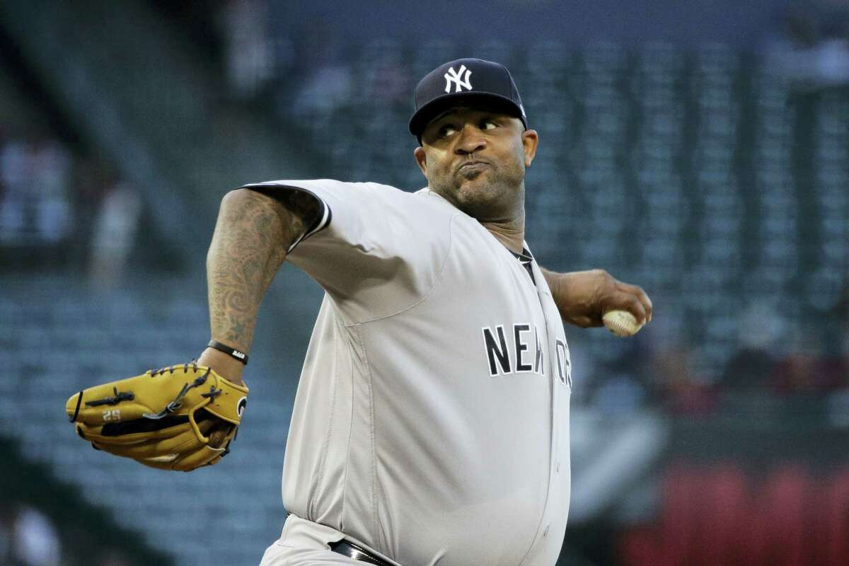New York Yankees starting pitcher CC Sabathia throws against the Los Angeles Angels during the first inning of a baseball game, Tuesday in Anaheim