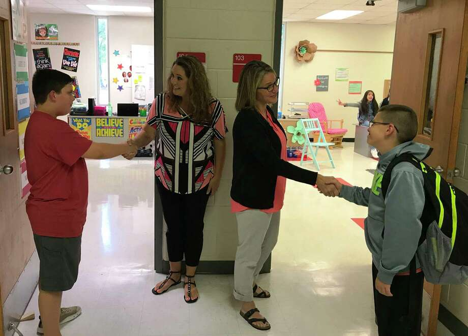SJH Teachers Tamara Abke and Jennifer Jones welcome students into their classrooms. Photo: Submitted