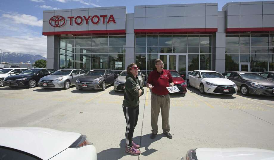 A car shopper speaks with a Toyota salesman in Salt Lake City. The lack of women on car dealers' sales floors starts with lackluster hiring efforts. More than 60 percent of female dealership employees surveyed by CDK in May said their companies weren't doing anything to help recruit more women. Photo: Rick Bowmer /Associated Press / Copyright 2017 The Associated Press. All rights reserved.