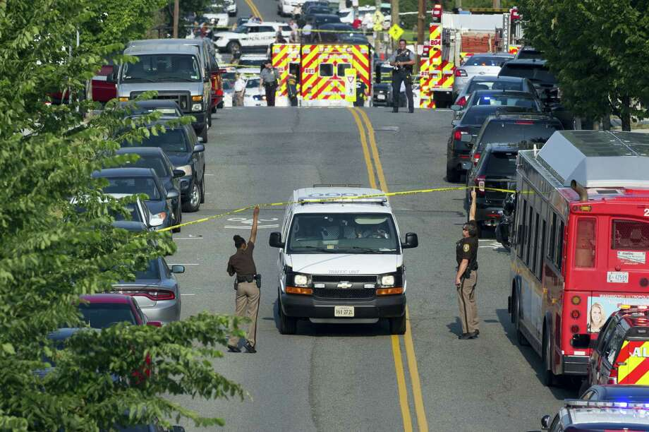 Police and emergency personnel are seen near the scene where House Majority Whip Steve Scalise of La. was shot during a Congressional baseball practice in Alexandria, Va. on June 14, 2017. Photo: AP Photo — Cliff Owen  / FR170079 AP