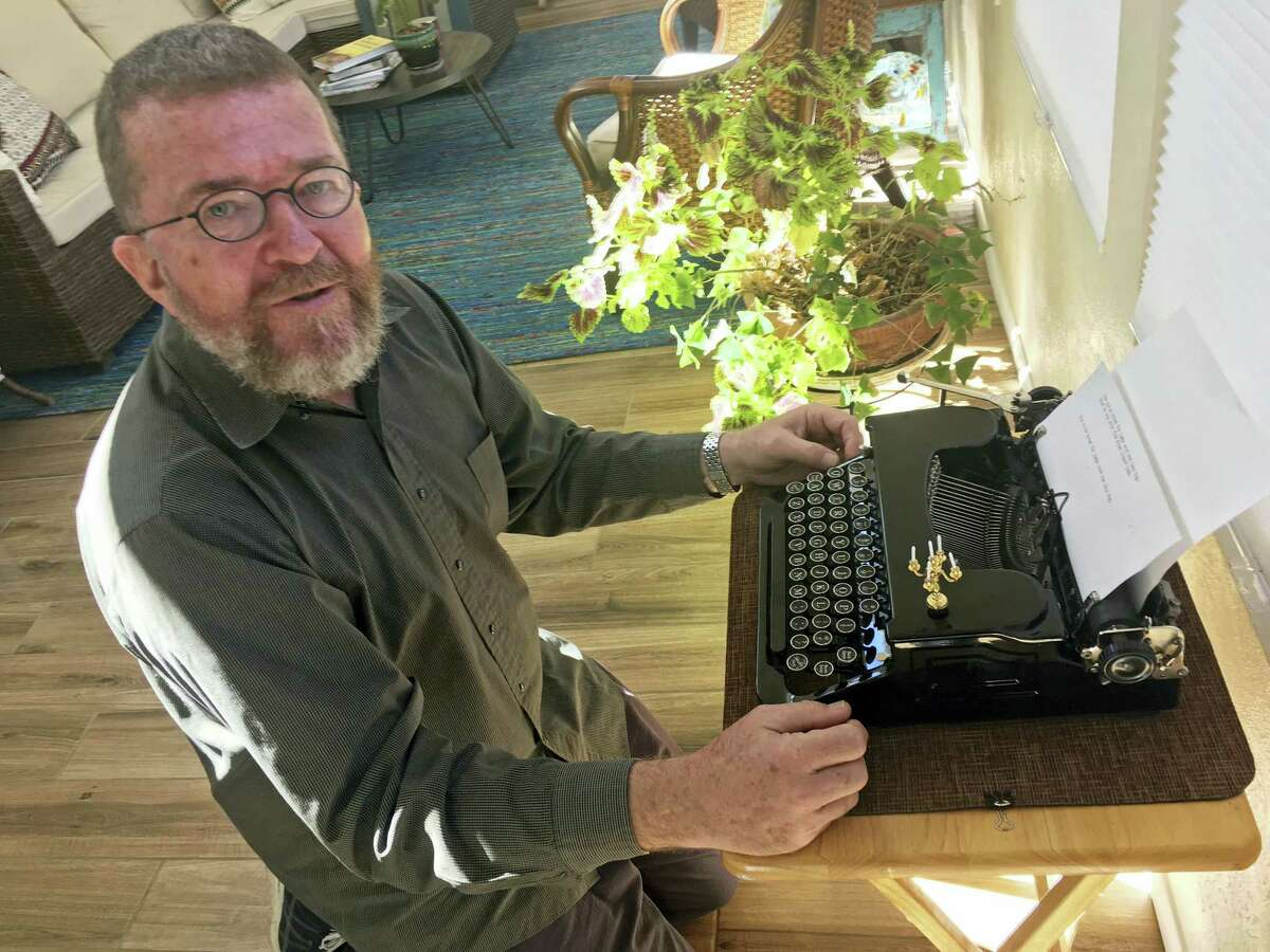 In this Feb. 21, 2017 photo, Joe Van Cleave, who runs a popular YouTube channel on restoring typewriters, speaks about one of his vintage typewriters at his home in Albuquerque, N.M. The vintage typewriter is making a comeback with a new generation of fans gravitating to machines that once gathered dust.