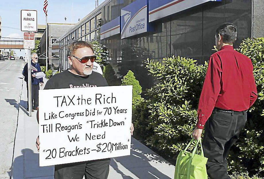 In this April 17, 2012, photo, James Hodgkinson of Belleville protests outside of the United States Post Office in Downtown Belleville, Ill. A government official says the suspect in the Virginia shooting that injured Rep. Steve Scalise and several others has been identified Hodgkinson. Photo: Derik Holtmann/Belleville News-Democrat, Via AP