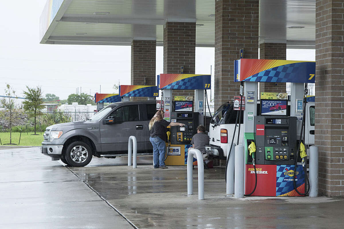 Customers fuel vehicles at a Sunoco LP gas station ahead of Hurricane Harvey in Texas City, Texas, U.S., on Friday, Aug. 25, 2017. Hurricane Harveystrengthened as it headed toward landfall in Texas, forecast to become the worst storm to strike the region in more than a decade. The price of gasolineralliedas it threatened to wreak havoc on the heart of America's energy sector.