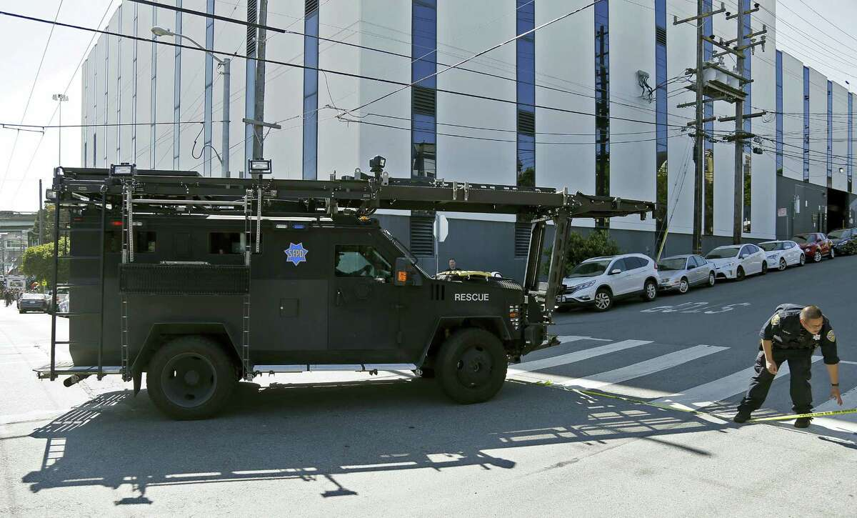 A San Francisco police armored vehicle arrives outside a UPS package delivery warehouse where a shooting took place Wednesday, June 14, 2017, in San Francisco. A UPS spokesman says four people were injured in the shooting at the facility and that the shooter was an employee.