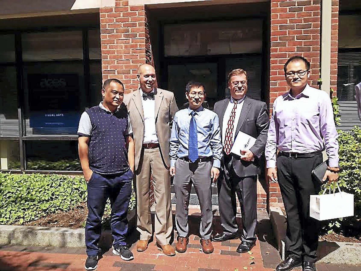 (Brian Zahn - New Haven Register) From left, Liu Xuguang, Jason Hiruo, Jin Yunhua, Tim Howes and Feng Ruobing, following a meeting to discuss an agreement between ACES ECA and the Chinese Service Center for Scholarly Exchange.