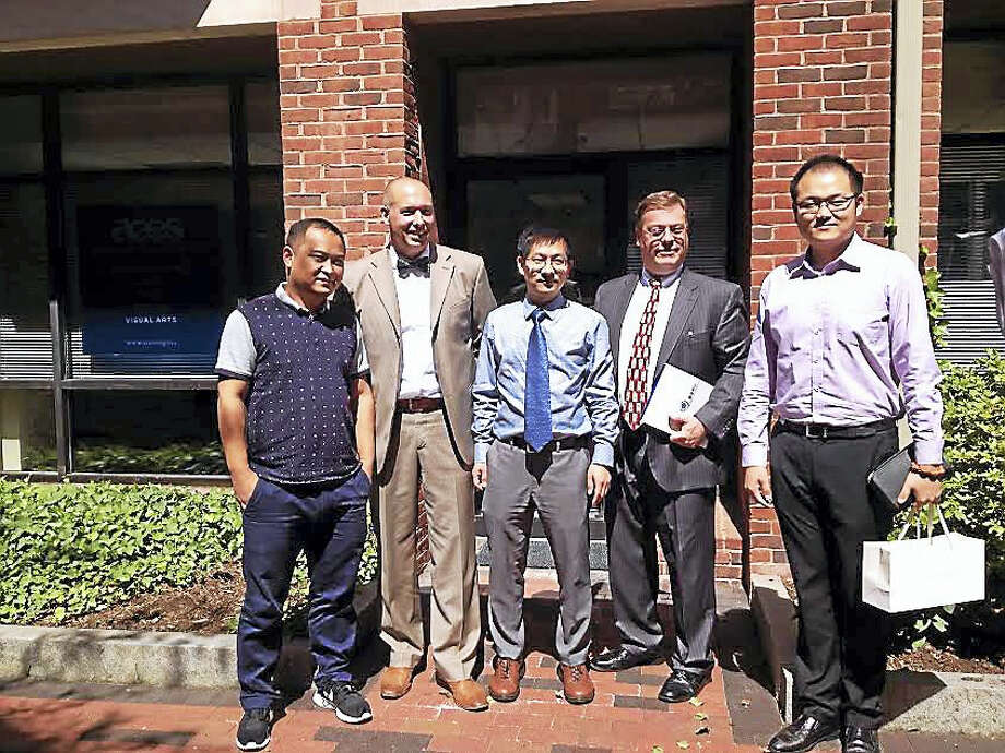 (Brian Zahn - New Haven Register) From left, Liu Xuguang, Jason Hiruo, Jin Yunhua, Tim Howes and Feng Ruobing, following a meeting to discuss an agreement between ACES ECA and the Chinese Service Center for Scholarly Exchange. Photo: Digital First Media