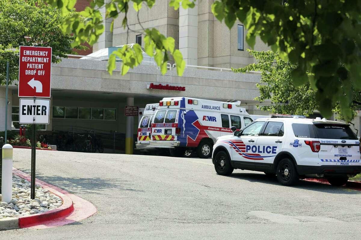 Police car and ambulances are seen outside of the emergency entrance at MedStar Washington Hospital Center in Washington, Wednesday, June 14, 2017.