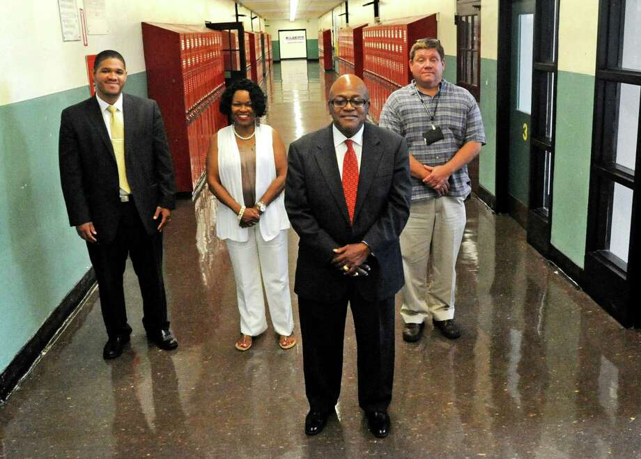 Byron Williams, front center, the new principal at Bassick High School, and his team of assistant principals, Beswick Channer, Carmen McPherson and James Denton, at the campus in Bridgeport, Conn. on Thursday, August 24, 2017. Photo: Cathy Zuraw / Hearst Connecticut Media / Connecticut Post