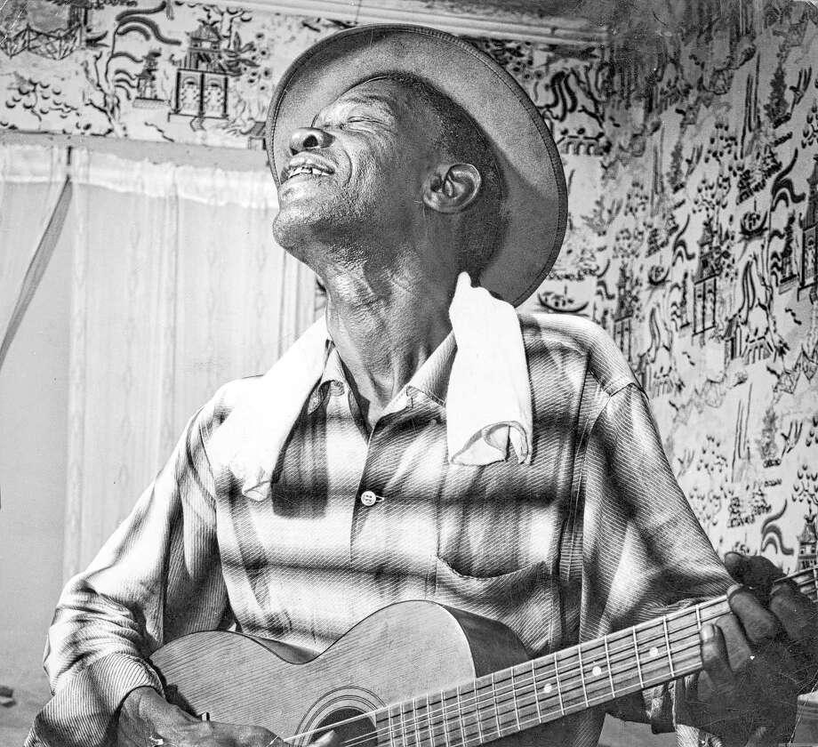 08/23/1959 - Blues guitarist Sam 'Lightnin' Hopkins. Photo: Andrew A. Hanson, HP Staff / Houston Post files
