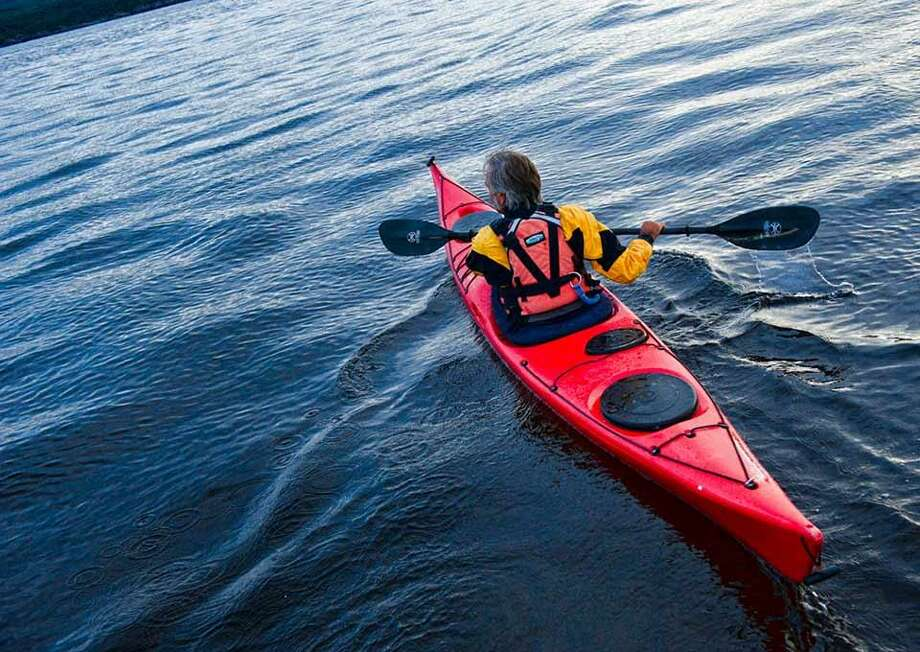 Seeing the Connecticut River by kayak or canoe can be a special experience, say folks at the Connecticut River Museum in Essex. Photo: Contributed Photo