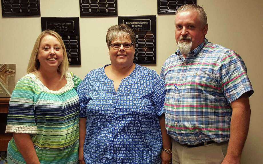 Splendora ISD employees Julie Bolster and Tammy Butts were recognized by the board of trustees during the August meeting. Pictured with them is Assistant Superintendent Kevin Lynch. Photo: Submitted