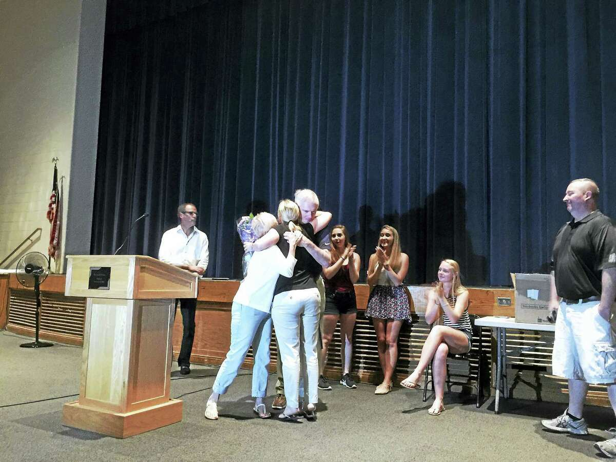 Maura Hurley was named the 2017 Teacher of the Year for The Gilbert School. Above, Hurley gets a hug from her family members, who attended the presentation on Tuesday.