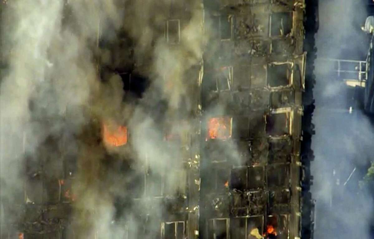 In this photo taken from video, smoke and flames from a high-rise apartment building on fire in London, Wednesday, June 14, 2017. A massive fire raced through the 27-story high-rise apartment building in west London early Wednesday, sending at least 30 people to hospitals, emergency officials said. (Sky News via AP)
