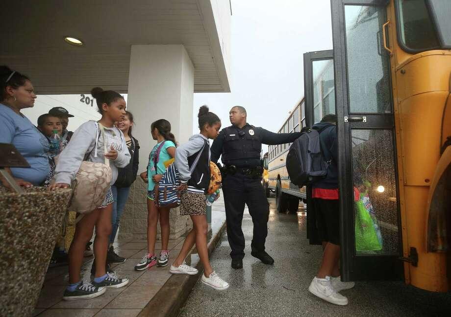 People evacuated from Matagorda County load up a school bus at the Bay City Civic Center before Hurricane Harvey made landfall Friday, Aug. 25, 2017, in Bay City, Texas. Photo: Godofredo A. Vasquez, Houston Chronicle / Godofredo A. Vasquez