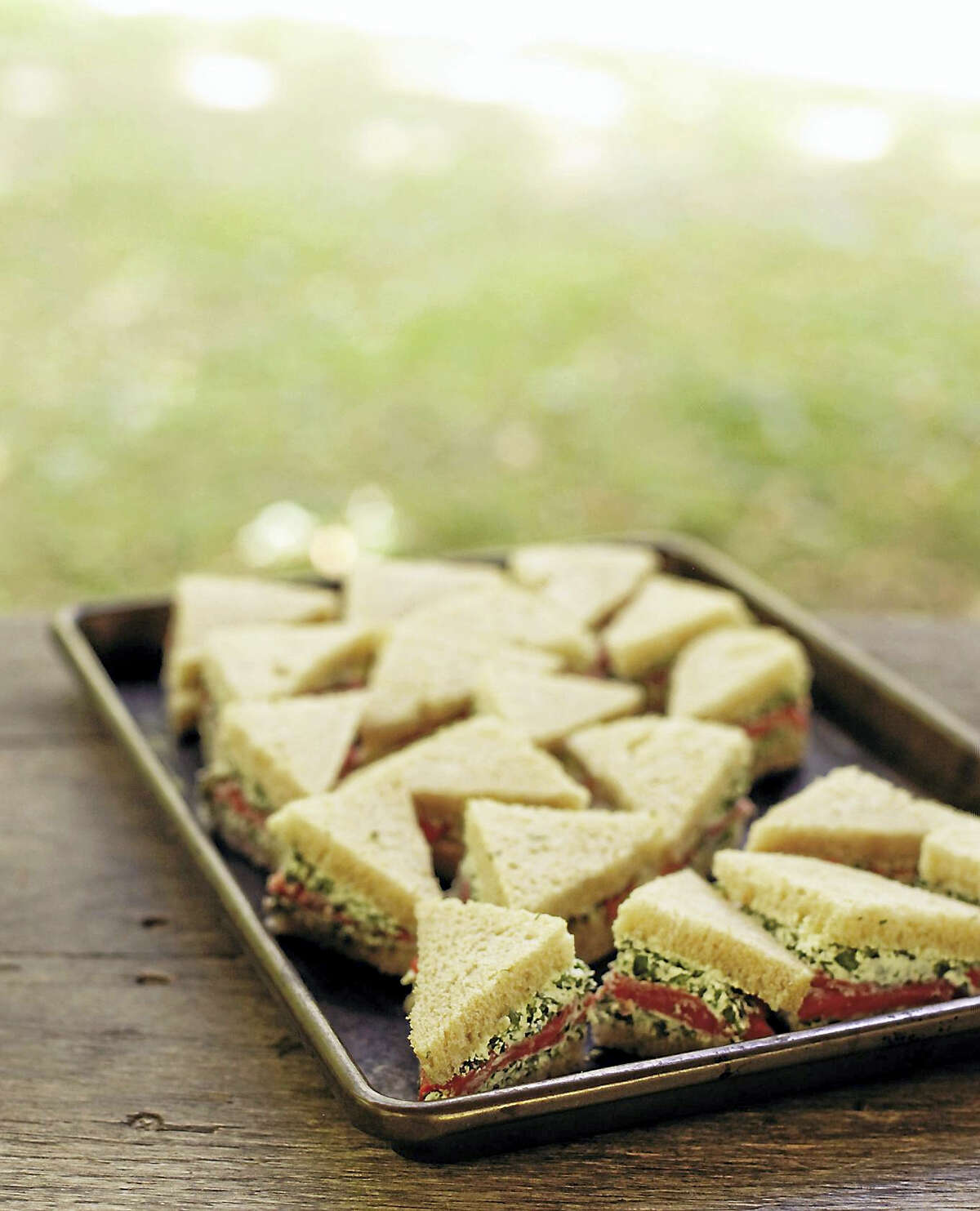 Smoked salmon and herb finger sandwiches.