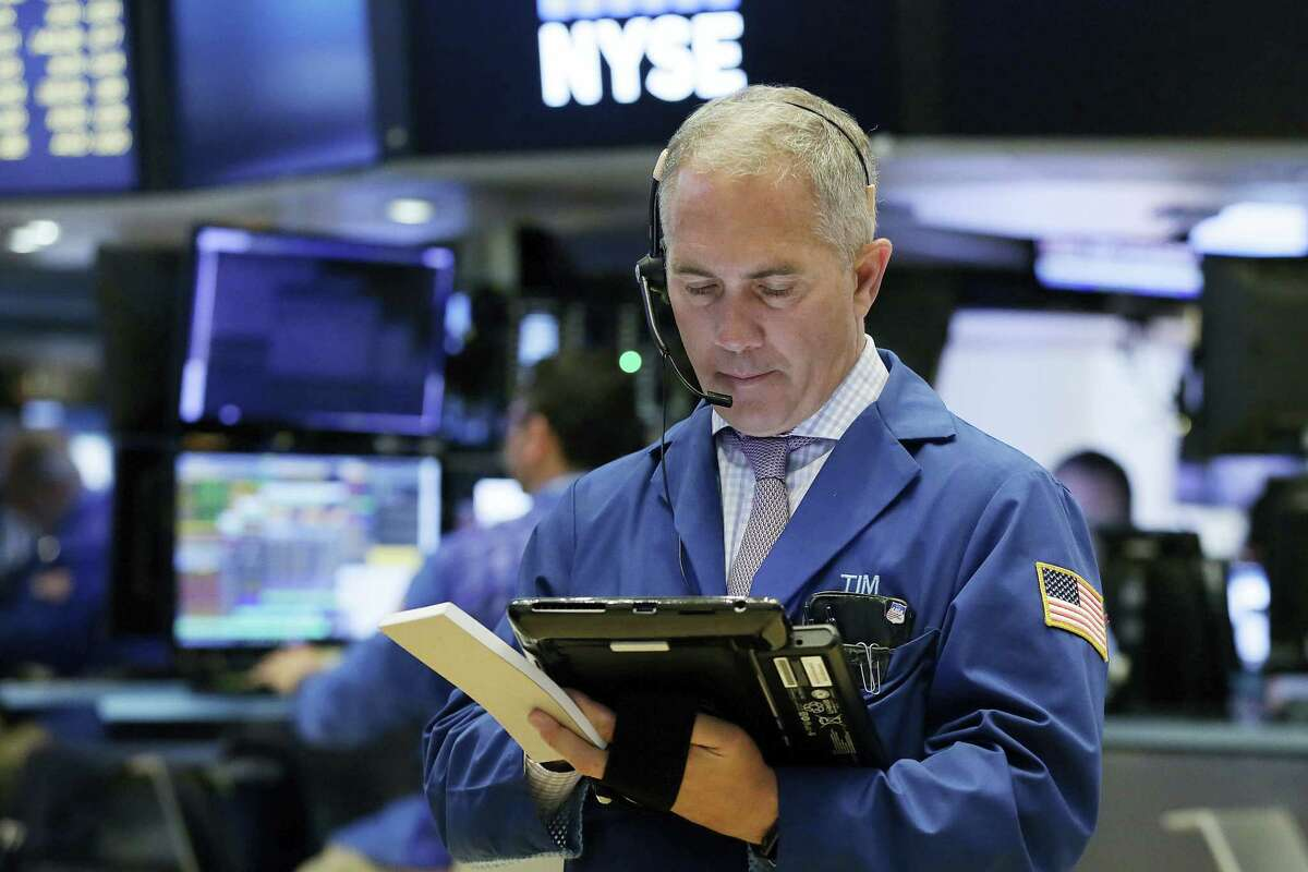 Trader Timothy Nick works on the floor of the New York Stock Exchange Wednesday.