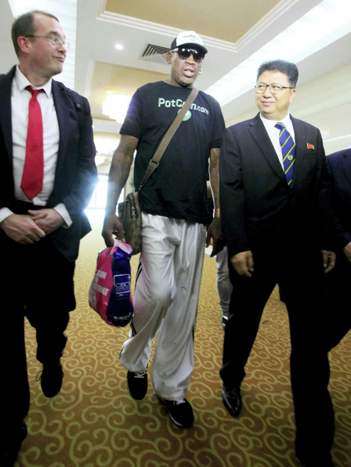 Former NBA basketball star Dennis Rodman is greeted by North Korea's Sports Ministry Vice Minister Son Kwang Ho, right, upon his arrival at Sunan International Airport on Tuesday, June 13, 2017, in Pyongyang, North Korea.