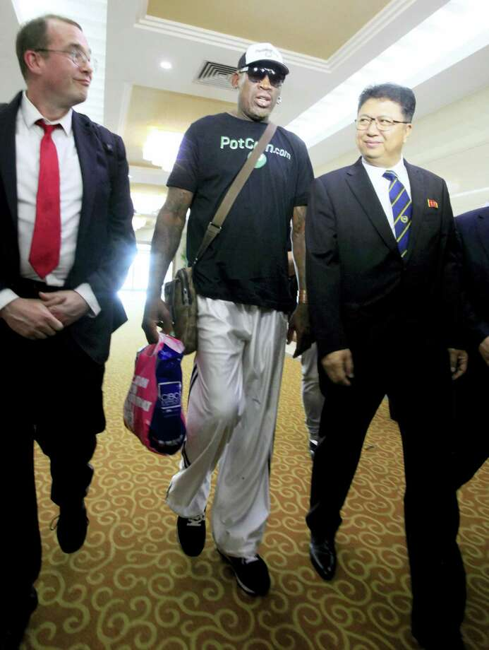 Former NBA basketball star Dennis Rodman is greeted by North Korea's Sports Ministry Vice Minister Son Kwang Ho, right, upon his arrival at Sunan International Airport on Tuesday, June 13, 2017, in Pyongyang, North Korea. Photo: AP Photo/Kim Kwang Hyon   / Copyright 2017 The Associated Press. All rights reserved.