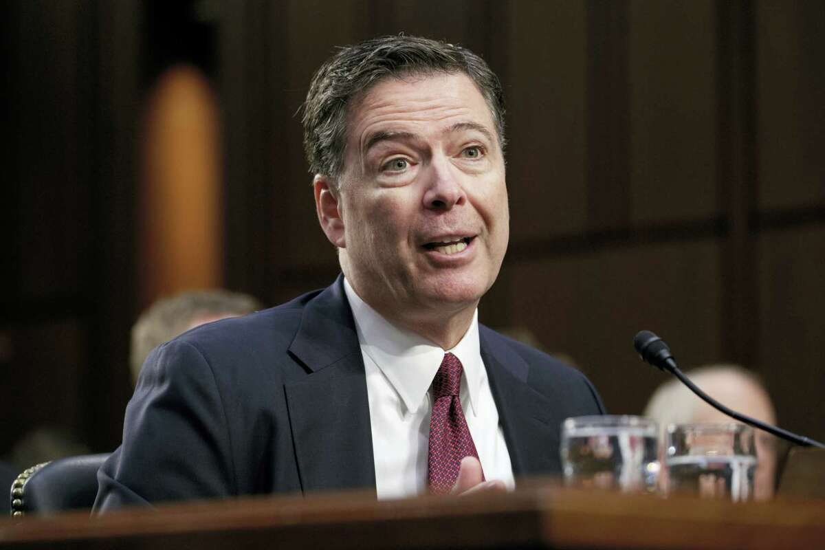 "Former FBI director James Comey recounts a series of conversations with President Donald Trump as he testifies before the Senate Select Committee on Intelligence, on Capitol Hill in Washington, Thursday, June 8, 2017. Comey alleges Trump repeatedly pressed him for his ""loyalty"" and directly pushed him to ""lift the cloud"" of investigation by declaring publicly the president was not the target of the probe into his campaign's Russia ties."