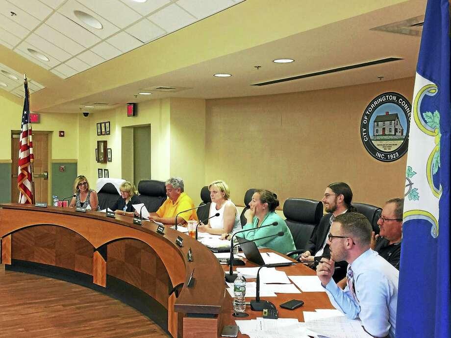 Torrington officials discuss approving a budget and setting a tax rate Monday evening. Photo: Ben Lambert — The Register Citizen