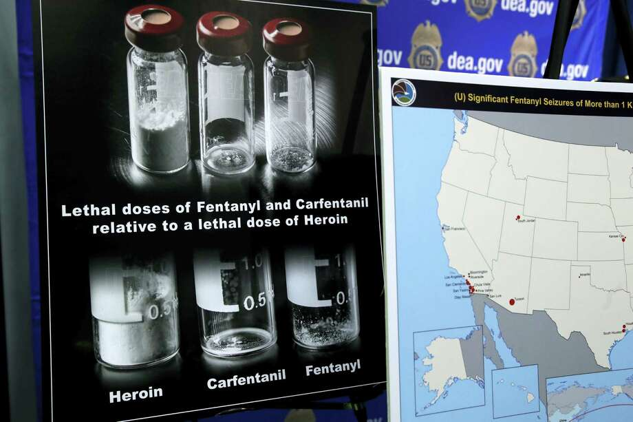 Posters comparing lethal amounts of heroin, fentanyl, and carfentanil, are on display during a news conference about the dangers of fentanyl, at DEA Headquarters in Arlington Va. on June 6, 2017. Photo: AP Photo — Jacquelyn Martin  / Copyright 2017 The Associated Press. All rights reserved.