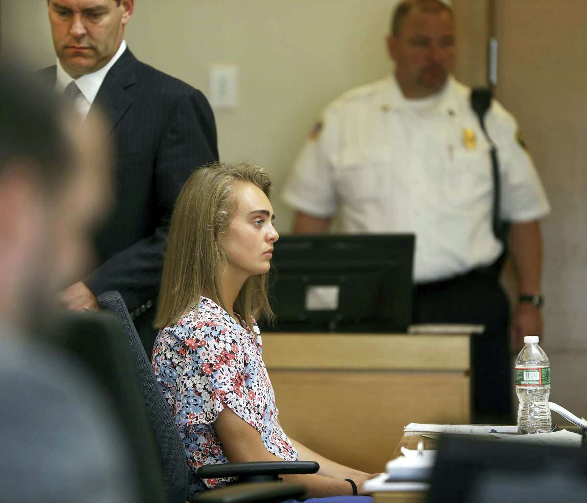 After a sidebar with Judge Lawrence Moniz (not seen) attorney Joe Cataldo, left, returns to the defense table, with his client Michelle Carter during her trial at Taunton Juvenile Court in Taunton, Mass., Tuesday, June 13, 2017. Carter is charged with involuntary manslaughter for encouraging Conrad Roy III to kill himself in July 2014.