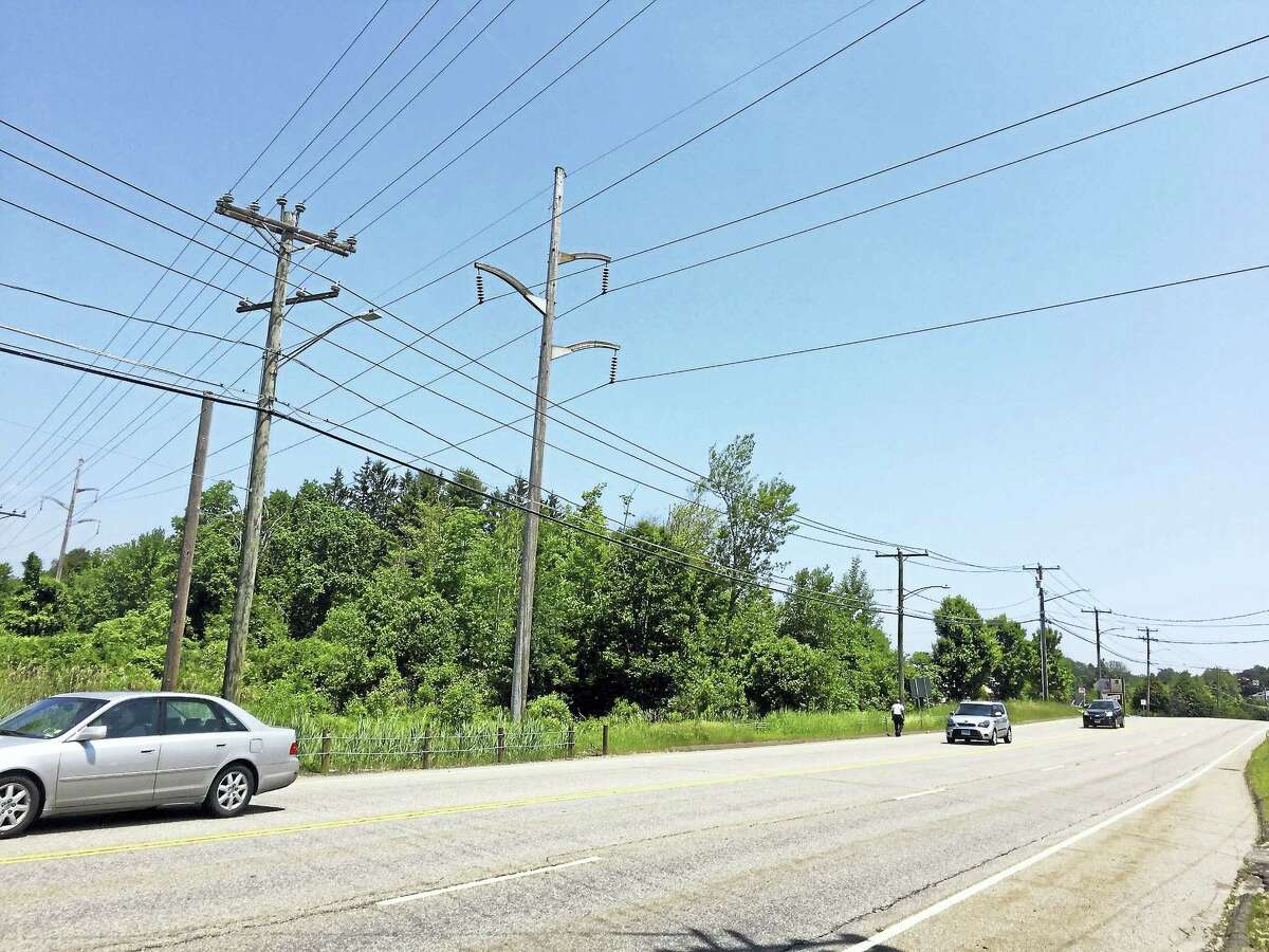 """People walking on East Main Street use what Torrington Mayor Elinor Carbone has called """"goat paths"""" because there are no sidewalks. Now the city is applying for a grant to build them."""
