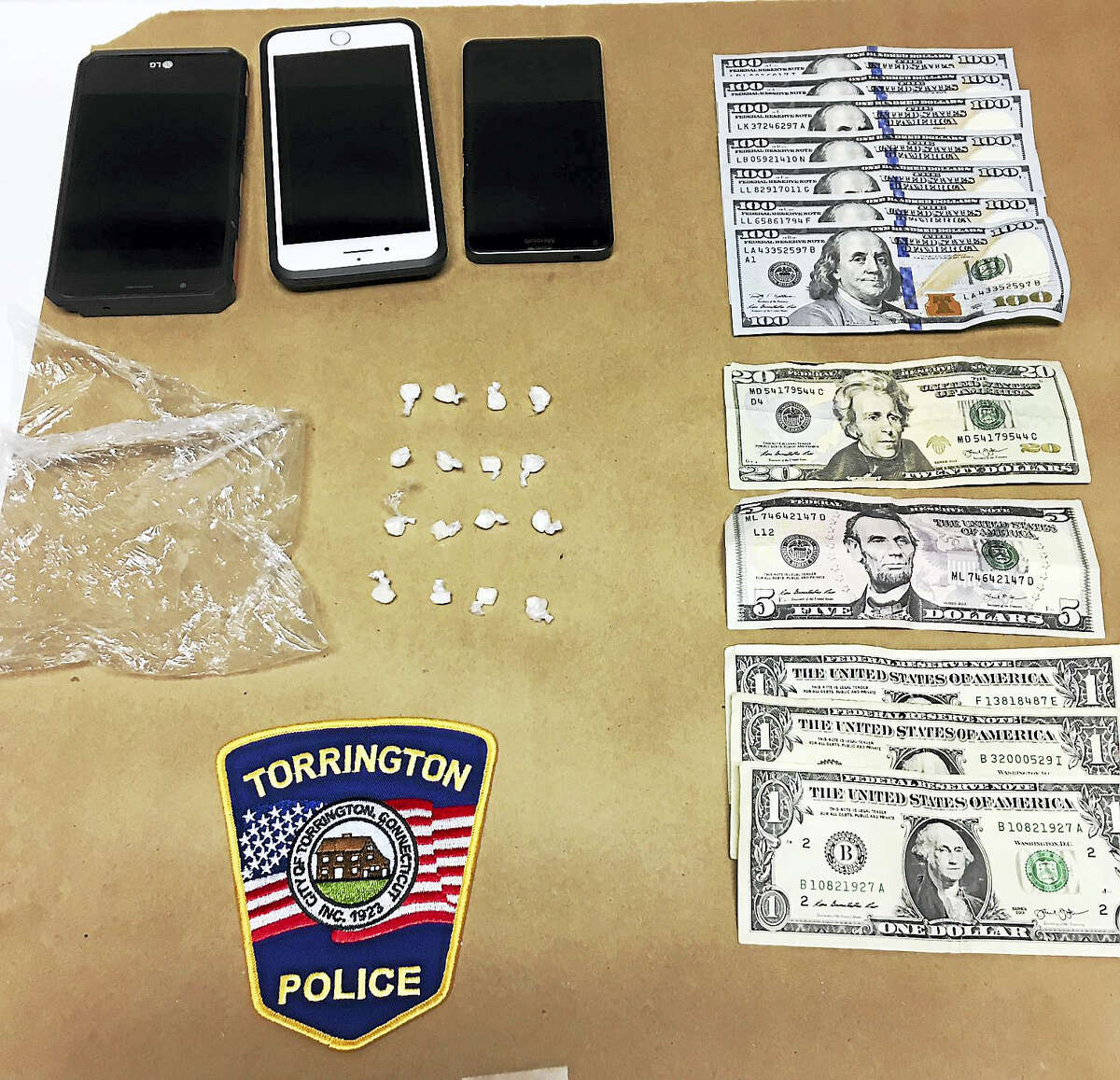 The crack cocaine, cash and cell phone seized by police from Richard Perry III.