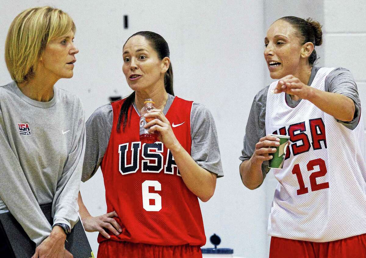 Diana Taurasi, right, and Sue Bird, center, talk with coach Chris Dailey during a U.S. women's national basketball team practice in 2011 in Las Vegas.