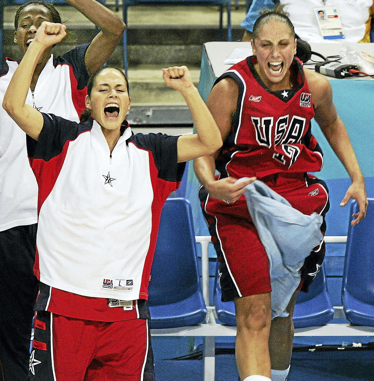 Sue Bird, left, and Diana Taurasi, right, cheer from the bench at the 2004 Olympic Games in Athens.