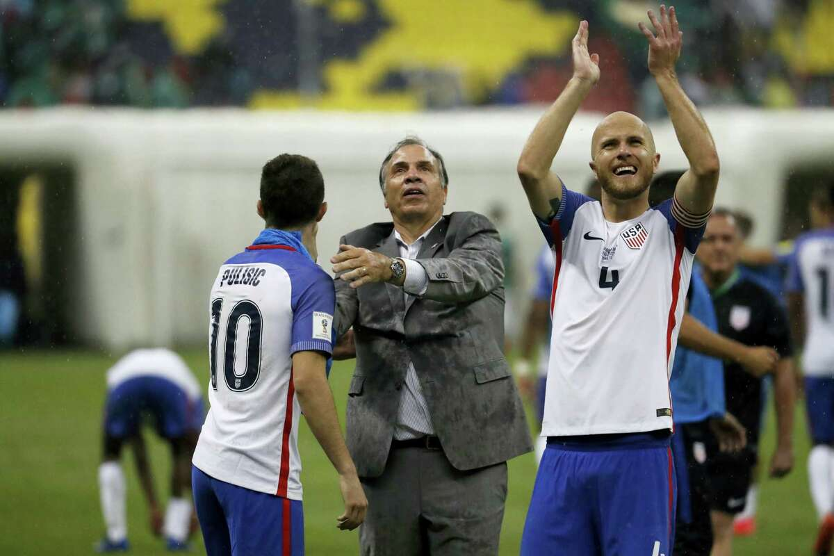 United States coach Bruce Arena, center, celebrates with Christian Pulisic, left, as Michael Bradley salutes supporters after their tie against Mexico on Sunday.