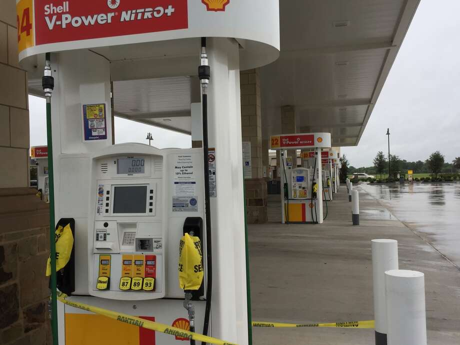 Sorry, out of service: Residents preparing for Hurricane Harvey emptied the tanks of this Shell station on Sienna Parkway in Missouri City, just one in the area to stand gas-less on Friday, Aug. 25.
