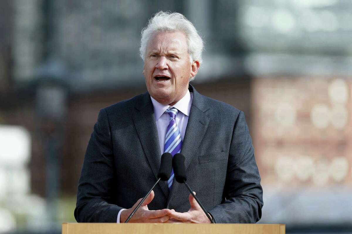 In this Monday file photo, General Electric CEO Jeff Immelt speaks during a groundbreaking ceremony at the site of GE's new headquarters, in Boston. General Electric said Immelt is stepping down as CEO. John Flannery, president and CEO of the conglomerate's health care unit, will take over the post in August.