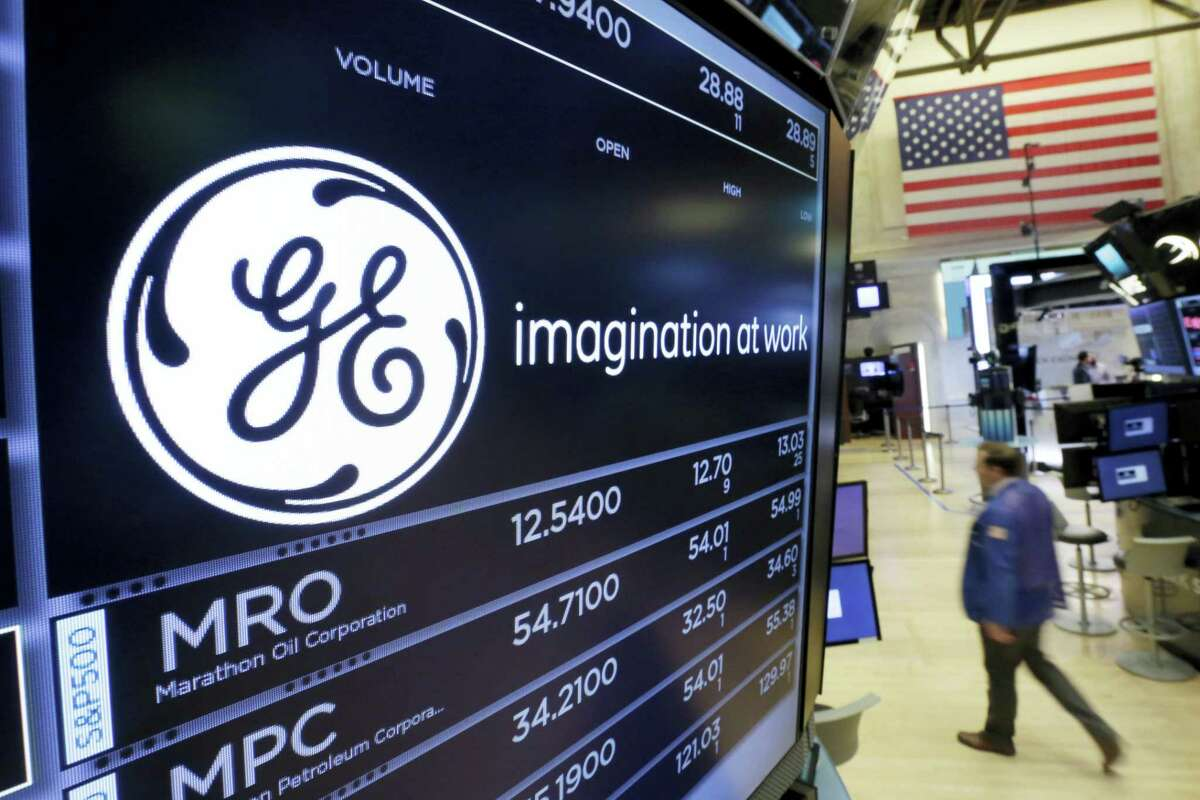 The General Electric logo appears above a trading post on the floor of the New York Stock Exchange, Monday. General Electric said Jeff Immelt is stepping down as CEO and John Flannery, president and CEO of the conglomerate's health care unit, will take over the post in August.